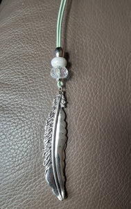 feather pendant on mint green leather cord with bead accents. Nice & Pretty Jewelry