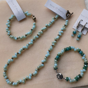 pale blue with hints of pale turquoise bead necklace. Pale blue sretch bracelet. Pale blue and green magentic clasp bracelet. Pale blue and green earrings. Nice and Pretty Jewelry handcrafted in Canada