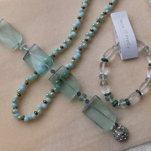 pale blue with hints of pale turquoise bead necklace. Glass bracelet with magnetic clasp, Glass stretch bracelet. Nice and Pretty Jewelry handcrafted in Canada
