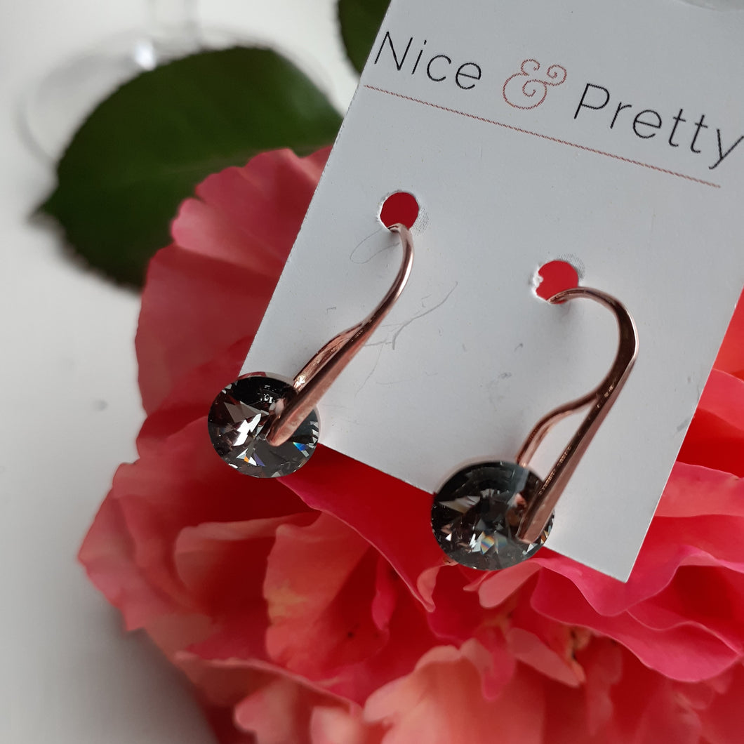 Black and gold crystal earring on rose gold earwire. Nice and Pretty Jewelry handcrafted in Canada.
