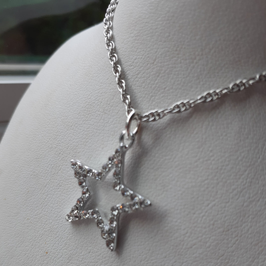 Rhinestone covered star necklace. Nice and Pretty Jewelry