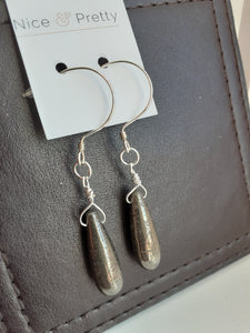 pyrite cylinder shaped earrings. Sterling silver loops. Nice and Pretty Jewelry handcrafted in Canada