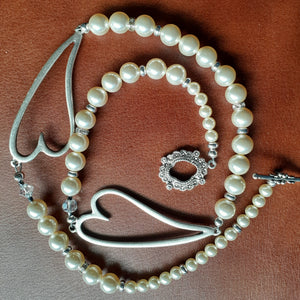 Swarovksi pearl necklace with hearts necklace. Nice and Pretty Jewelry