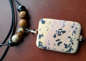 Jasper rectangular shaped pendant on leather cord. Nice and Pretty Jewelry