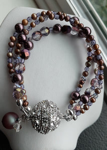 Purple multi strand bead bracelet. Nice and Pretty Jewelry