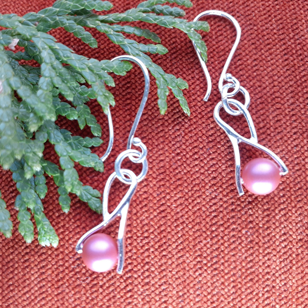 Swarovski rose pearl silver earrings. nice and pretty jewelry