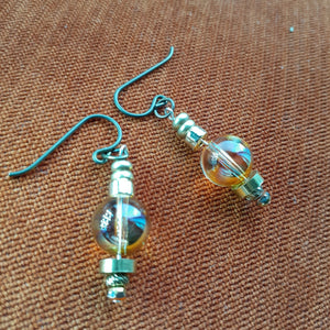 Swarovski crystal globe earrings with bronze accents. Handcrafted in Canada. Nice and Pretty Jewelry