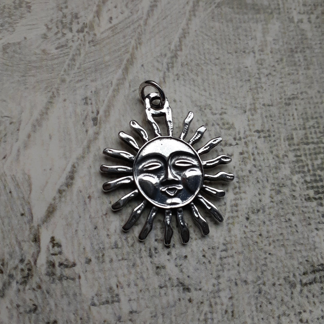 sterling silver sun pendant. nice and pretty jewelry