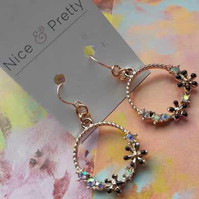 gold floral hoop earrings. nice and pretty jewelry