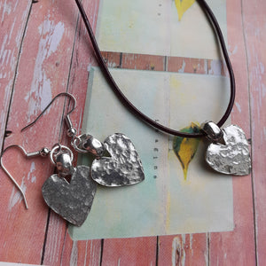 hammered silver heart on leather cord necklace. nice and pretty jewelry