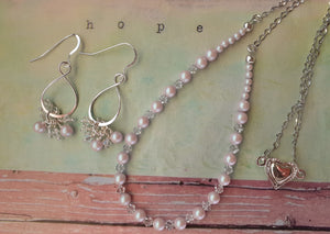 pale pink pearls and crystal necklace set. nice and pretty jewelry
