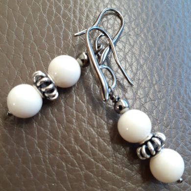 ivory and antique silver earrings. nice and pretty jewelry