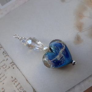 blue handcrafted glass heart pendant. nice and pretty jewelry
