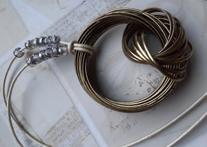 brass ring pendant. long impact necklace. leather cord brass necklace. nice and pretty jewelry