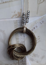 Load image into Gallery viewer, brass ring pendant. long impact necklace. leather cord brass necklace. nice and pretty jewelry