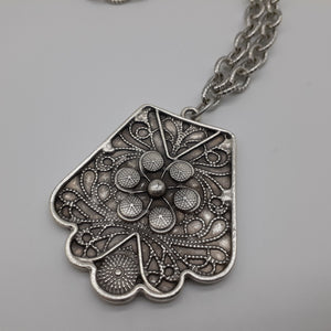 Floral design pewter pendant on heavy silver toned chain. Nice and Pretty Jewelry. Canada