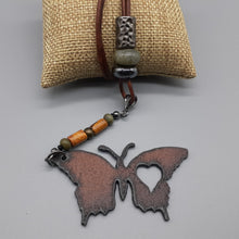 Load image into Gallery viewer, Butterfly pendant in rust finish. Butterfly pendant on leather necklace. Nice & Pretty Jewelry. Canada