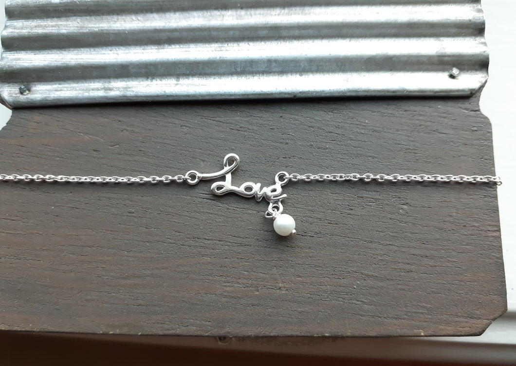 Sterling Silver anklet with love written in silver. Nice and Pretty Jewelry