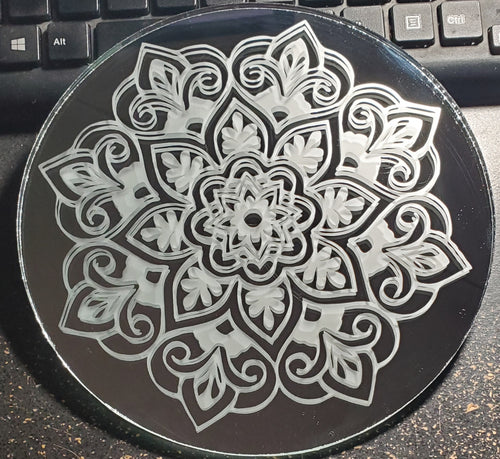 A mandala pattern etched into a mirror.