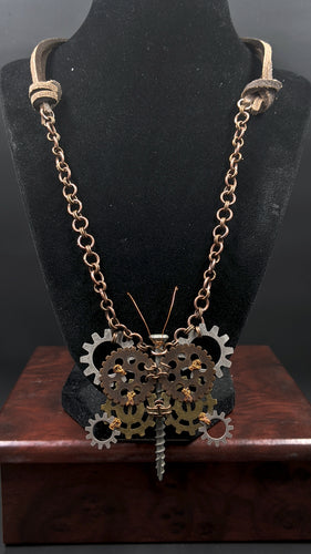 Slightly more simple than our Steampunk Bee Necklace, this necklace has a leather strap with a more intricate steampunk butterfly.  Hand crafted from gears and wire with a screw body, the butterfly is a symbol of renewal and rebirth, of change and growth. Remind yourself of your potential with this beautiful piece!