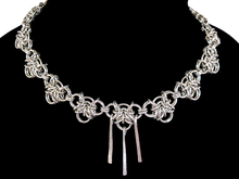 Load image into Gallery viewer, A necklace made of silver links in a woven pattern.