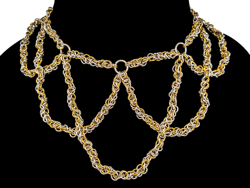 A necklace made of silver and gold links woven into chainmail ropes, intersecting each other to form a complex pattern.