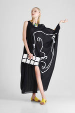Kaftan with abstract face appliqué and asymmetrical sleeves