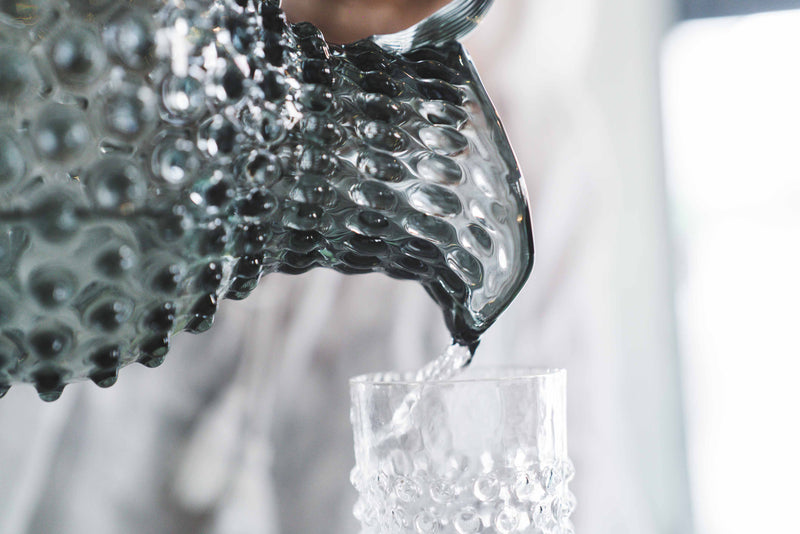 Close-up photo of Grey Smoke Hobnail Jug pouring water