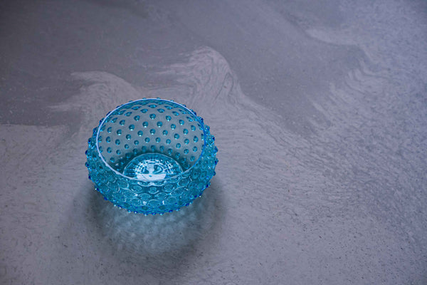 Azure Hobnail Bowl on the ground