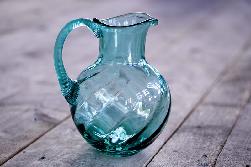 Beryl Marika Glass Jug on the wooden floor