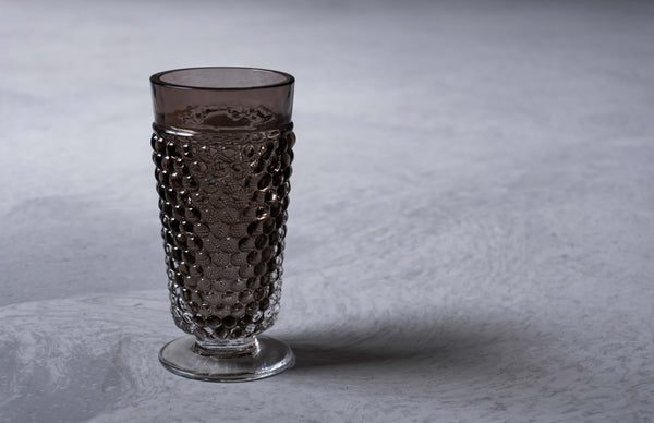 Close-up to Brown Smoke Hobnail Goblet