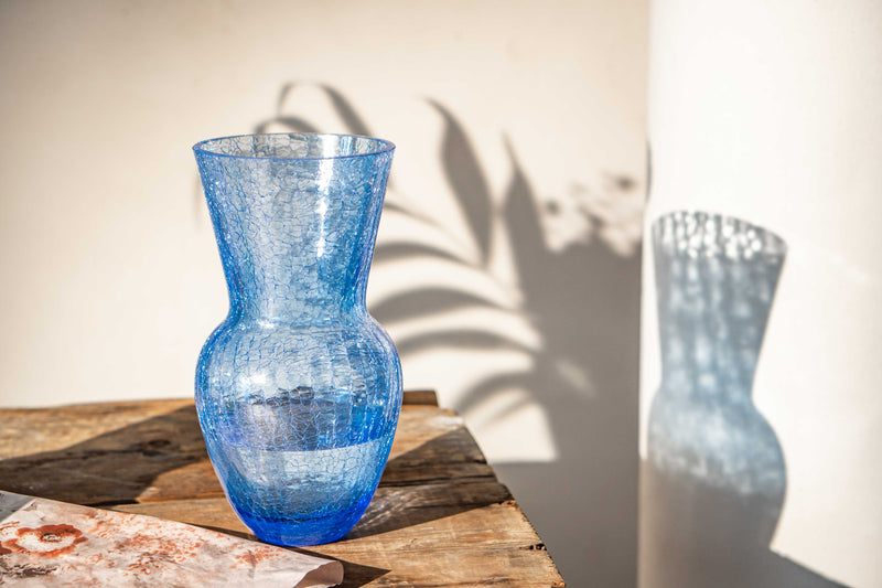 Blue Felicity Crackle Vase with its Shadows standing on the Table