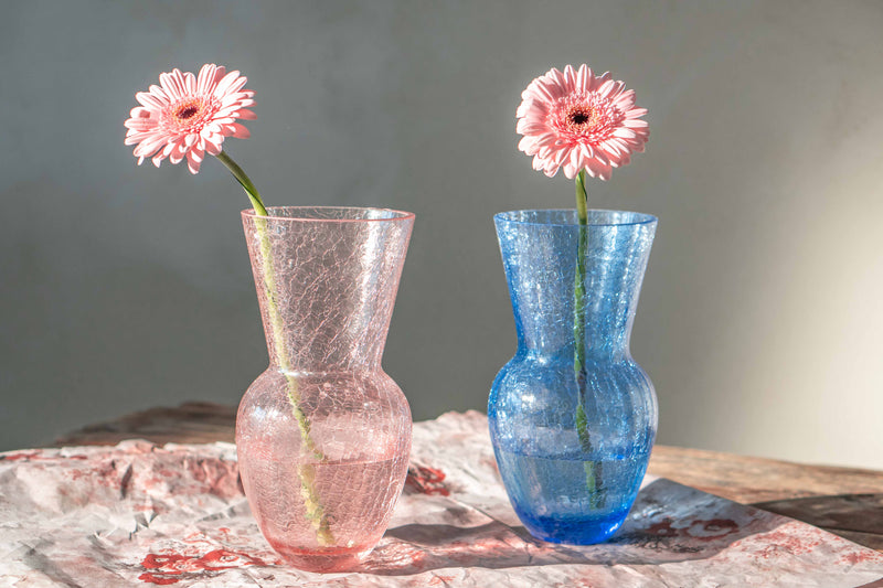 Rosaline and Blue Crackle Vases with Pink Flowers in them
