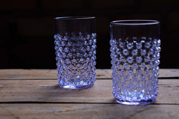 Close-up photos of tumblers standing on a wooden floor