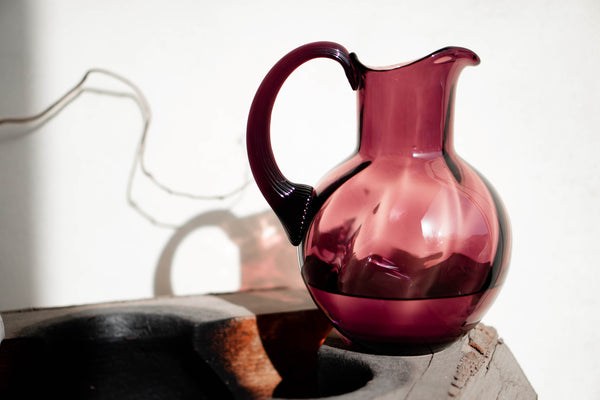 Glass Violet Jug on the wooden form