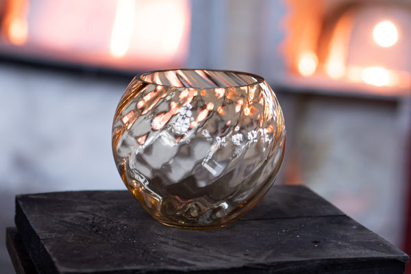 Underlay Marika Round Vase in a light of a glass furnace
