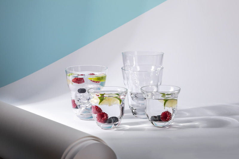 Different variations of Cloudless Clear Glasses with water and fruits inside