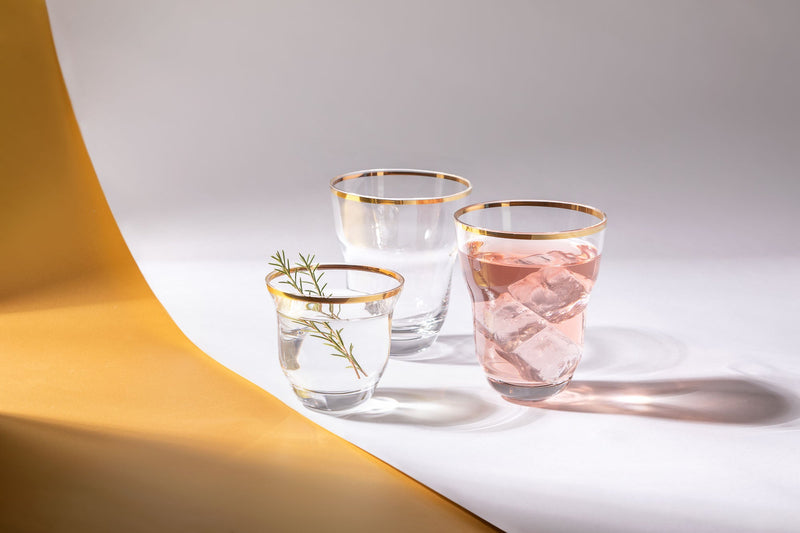 Golden Lux Drinkware from Shadows collection with yellow and white background