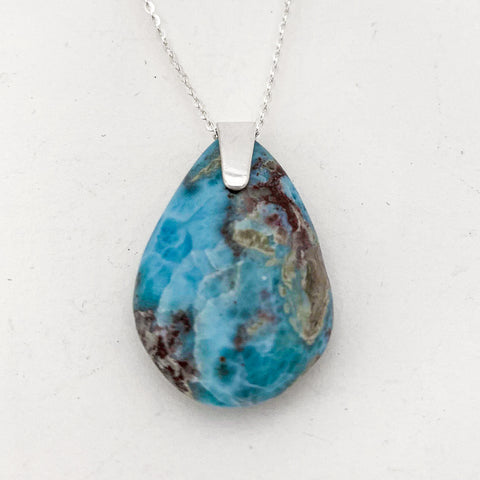 tear shape larimar with some beautiful red/gold marking on simple bail on sterling silver chain