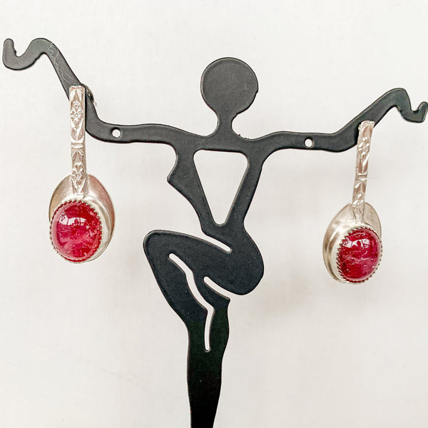 natural oval cabazon ruby embedded in sterling silver with sterling silver ear post