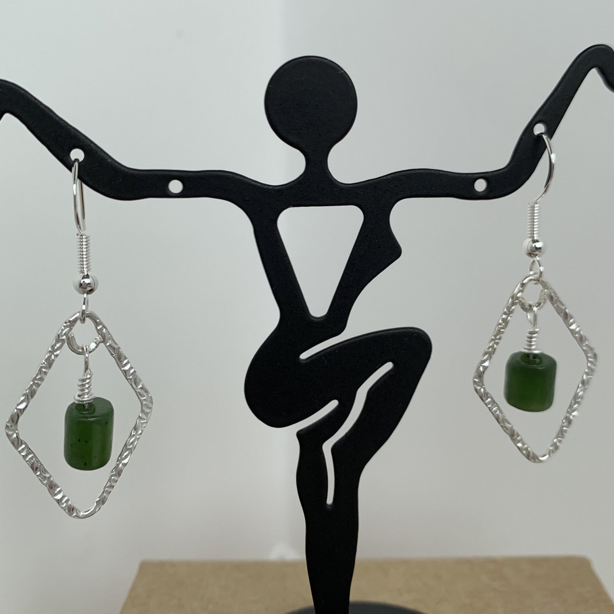 natural Canadian jade wire wrapped and dangled on sterling silver trapeszoid frame with sterling silver ear wire