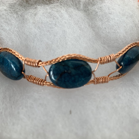 copper wires wrapped around 3 oval apatite stones finished with copper magnetic clasp