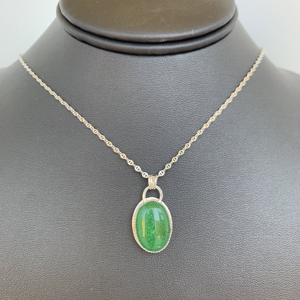 "Oval Malaysian jade mounted on sterling silver and 20"" sterling silver chain"