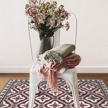 Load image into Gallery viewer, bordeaux color vinyl mat design  inspired by Spanish floor tiles under a sitting chair