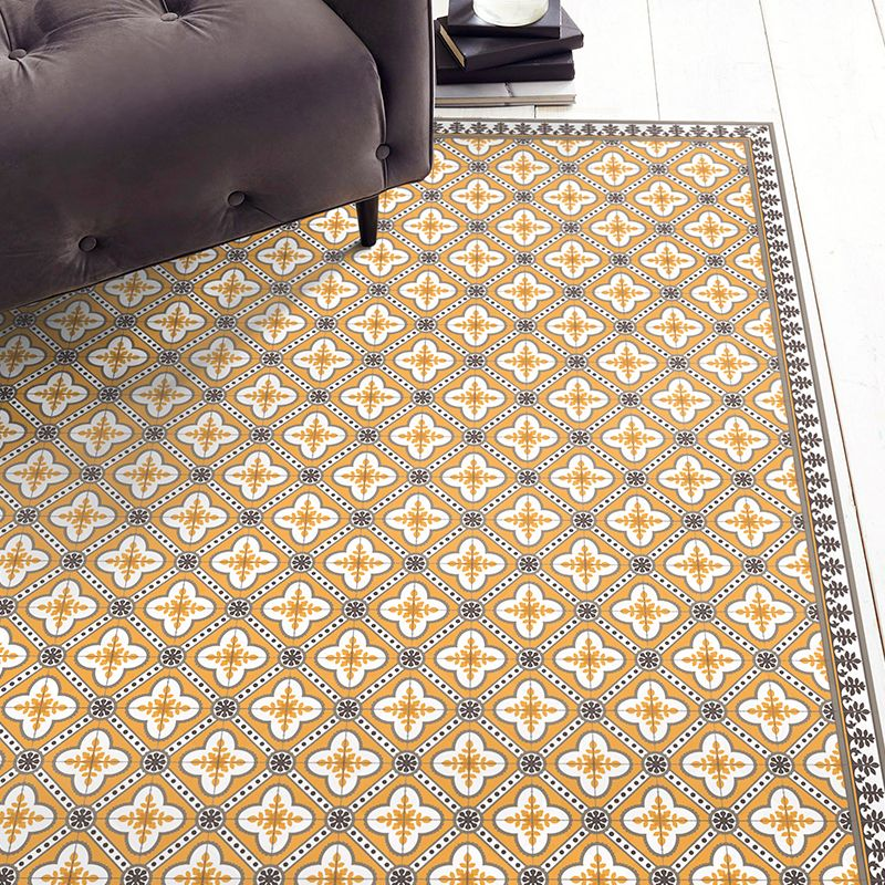 Golden color vinyl mat design inspired by Spanish floor tiles - located in a living room
