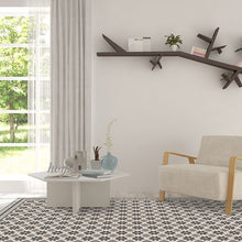 Load image into Gallery viewer, Grey vinyl mat inspired by Spanish floor tiles in a modern living room
