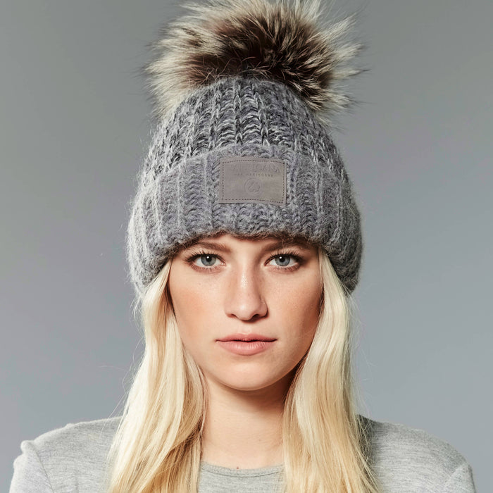 Chunky knit beanie with reused fur pom