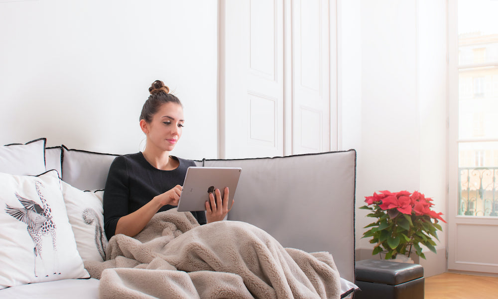 Woman with tablet sitting on couch
