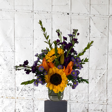 Sunny Days floral arrangement with sunflowers and purple accents