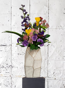 Colorful floral arrangement with purple, yellow, pink flowers